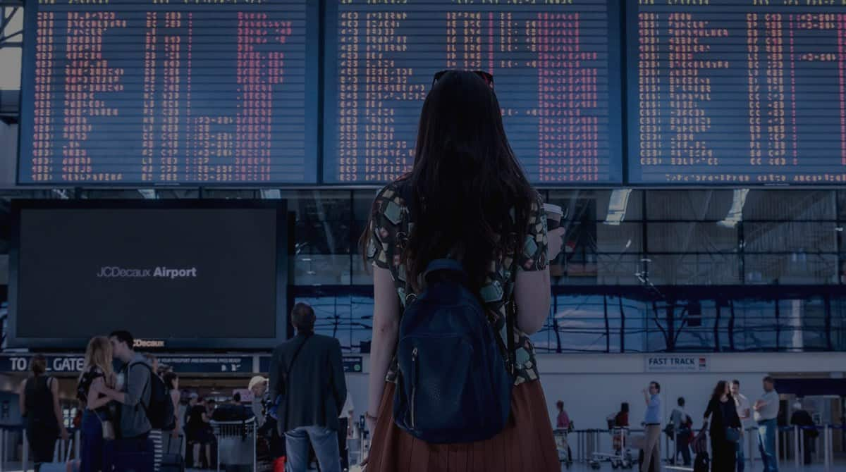 Woman traveler looking at a list of flights