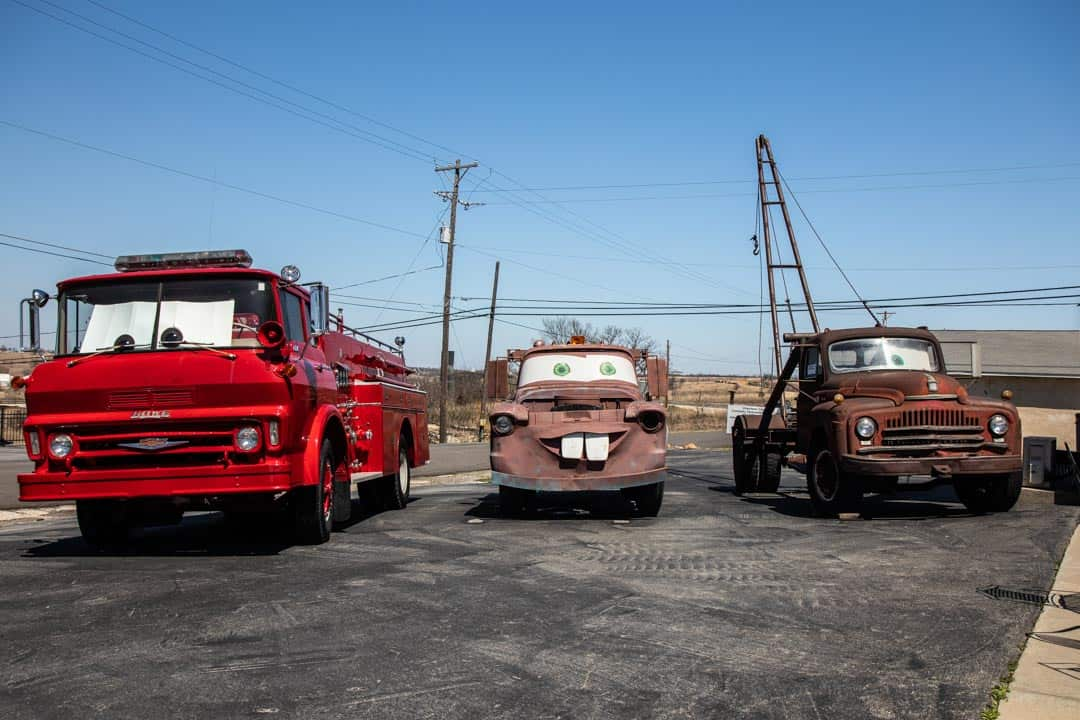 "Cars On The Route 66 Gas Station, Including Tow Mater From The Movie ""Cars"""