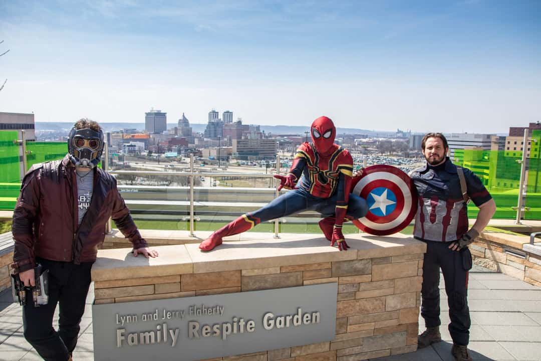 Marvel Characters posing with city skyline behind them