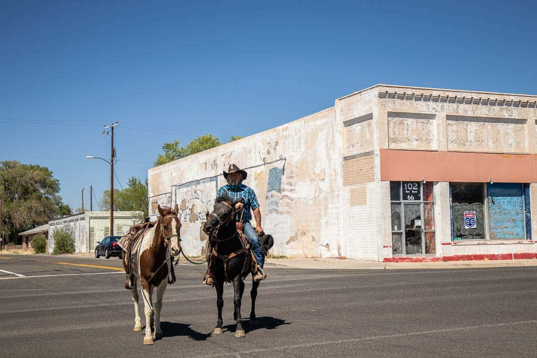 Cowboy with horses on the street in Seligman Arizona