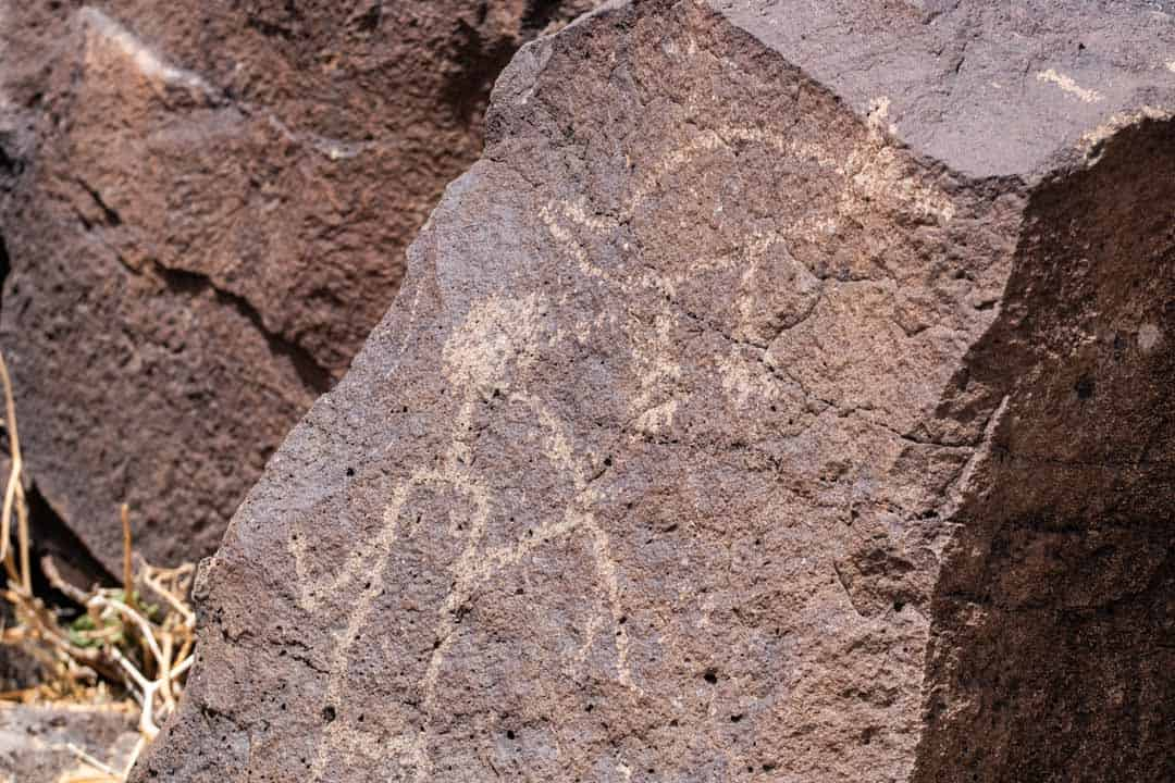 Petroglyphs Drawn on Rock of a Hunter