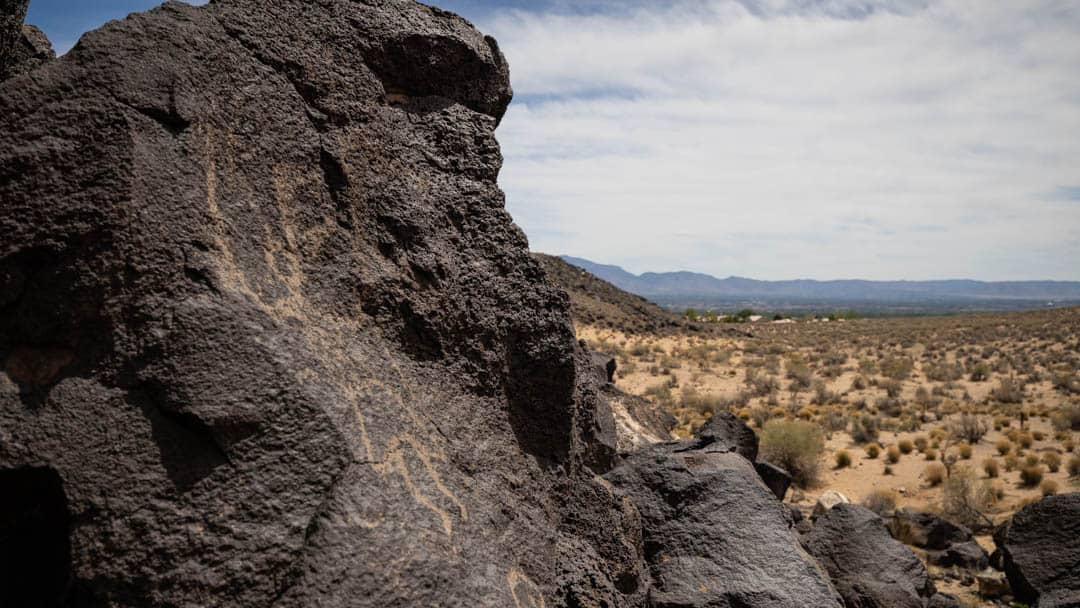 Petroglyphs cast in perspective to the desert