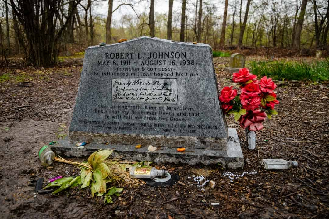 Trinkets Left in Honor of Robert Johnson Lie in a Muddy Mess Next to His Grave.