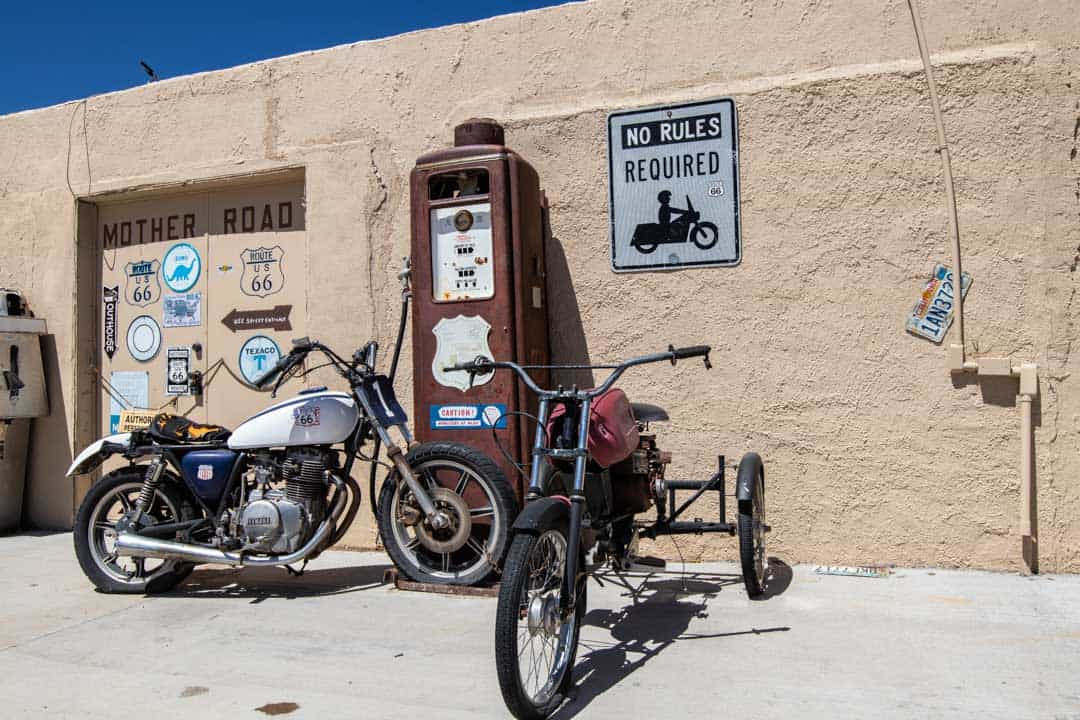 Vintage Motorcycles and gas pump along Route 66 in Ash Fork, Arizona
