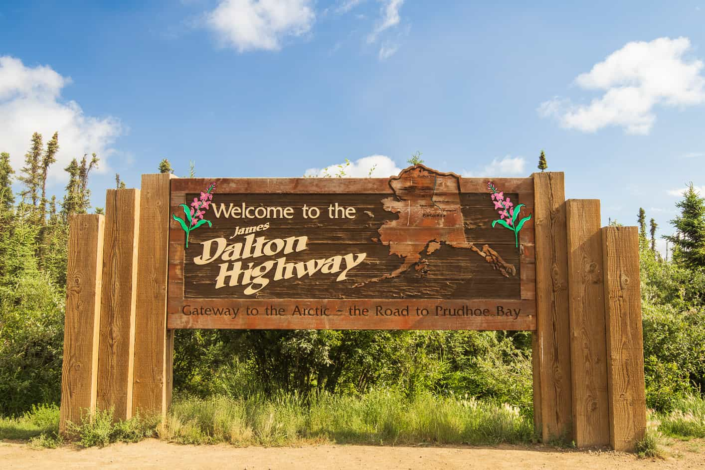 Large wooden Welcome to the Dalton Highway sign