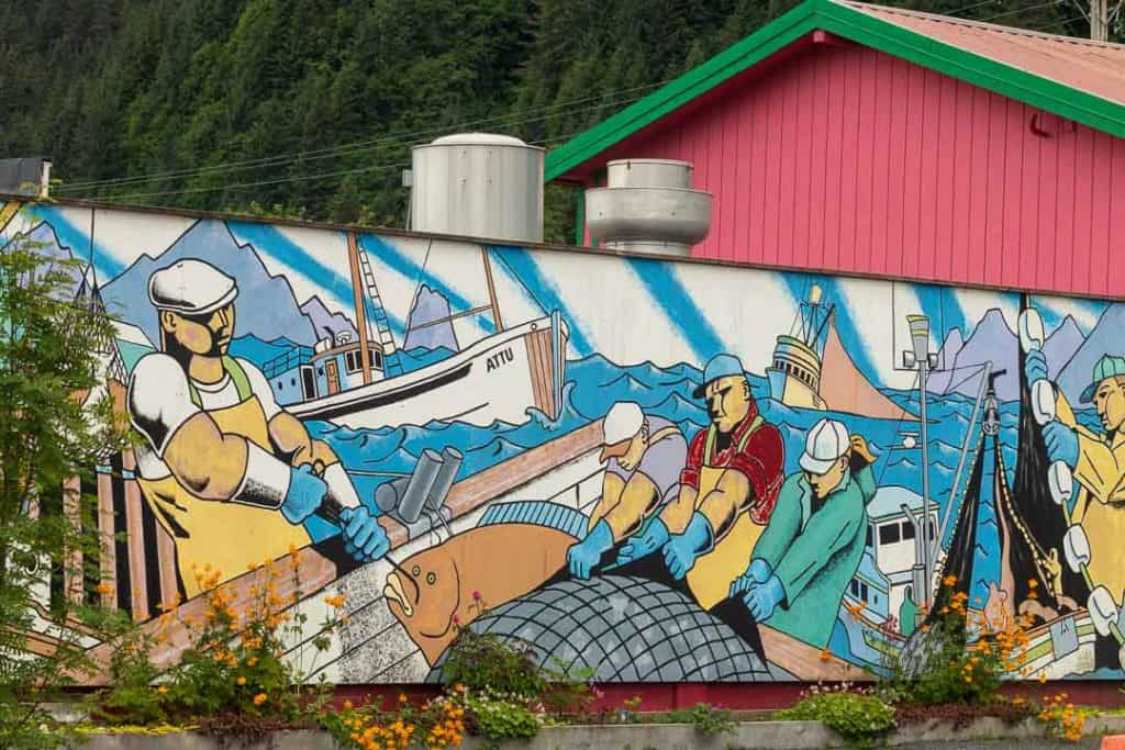 A mural of fishermen in downtown Seward tells the story of the town