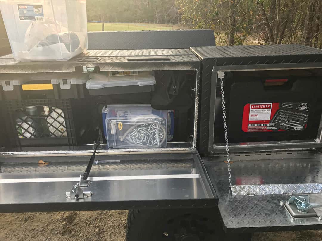 Storage boxes mounted to flatbed truck camper