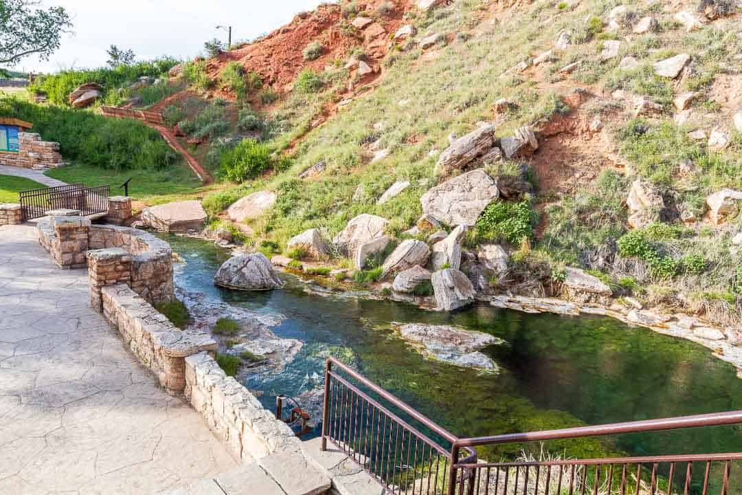 Large mineral hotspring with a viewing deck next to it
