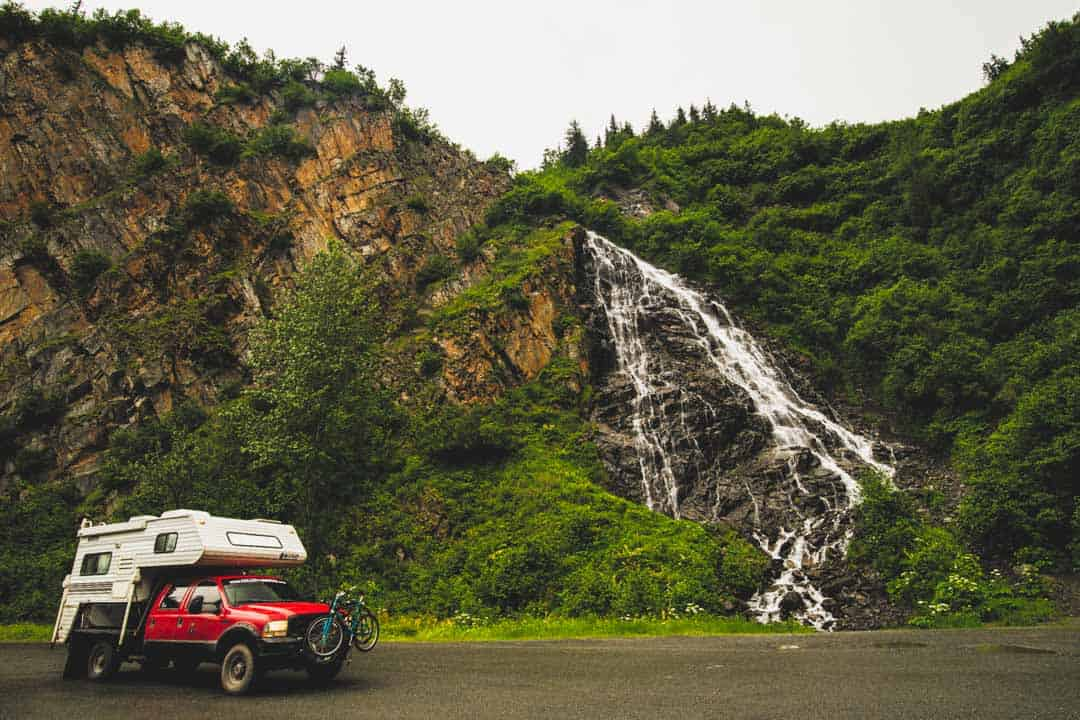 Truck next to waterfall in Valdez AK