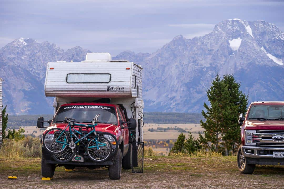 Camping with views of a mountain range in the background