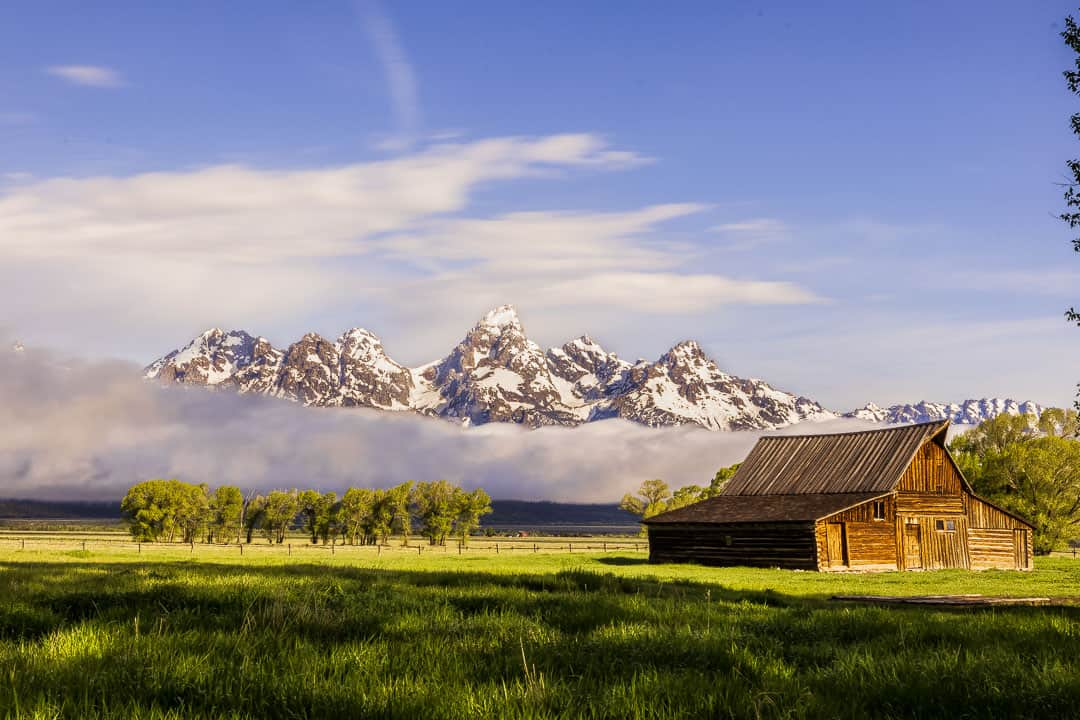 Old barn with a scenic view of the Teton mountain range