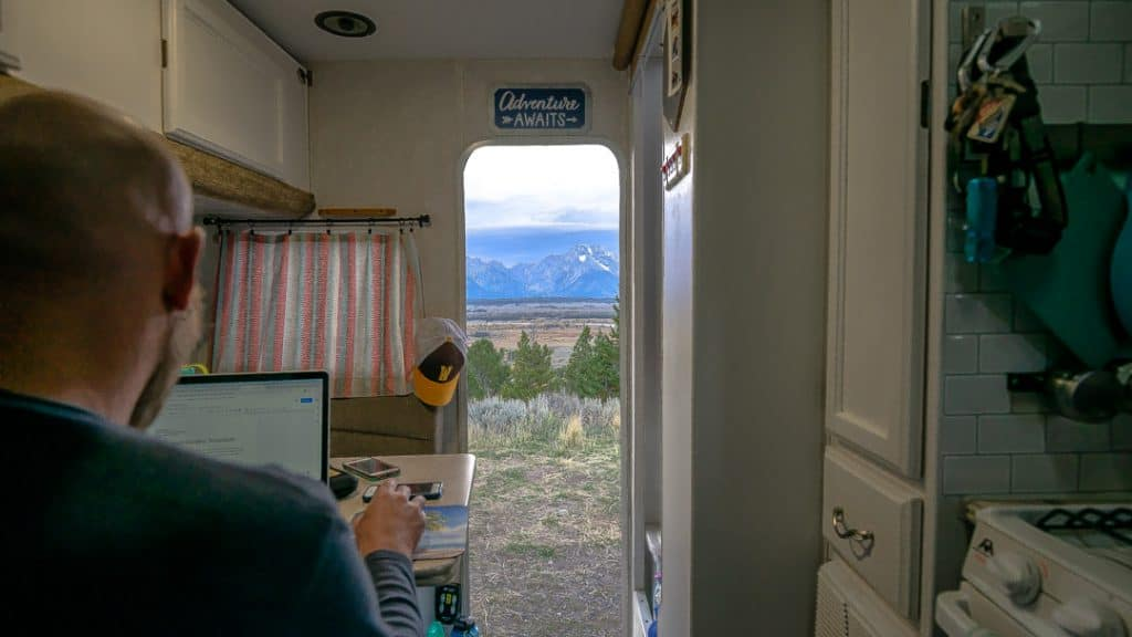 Working in camper with views of Grand Tetons