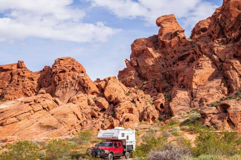 truck camper camping among red rocks