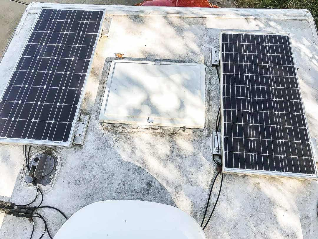 Two solar panels and vent on a RV roof