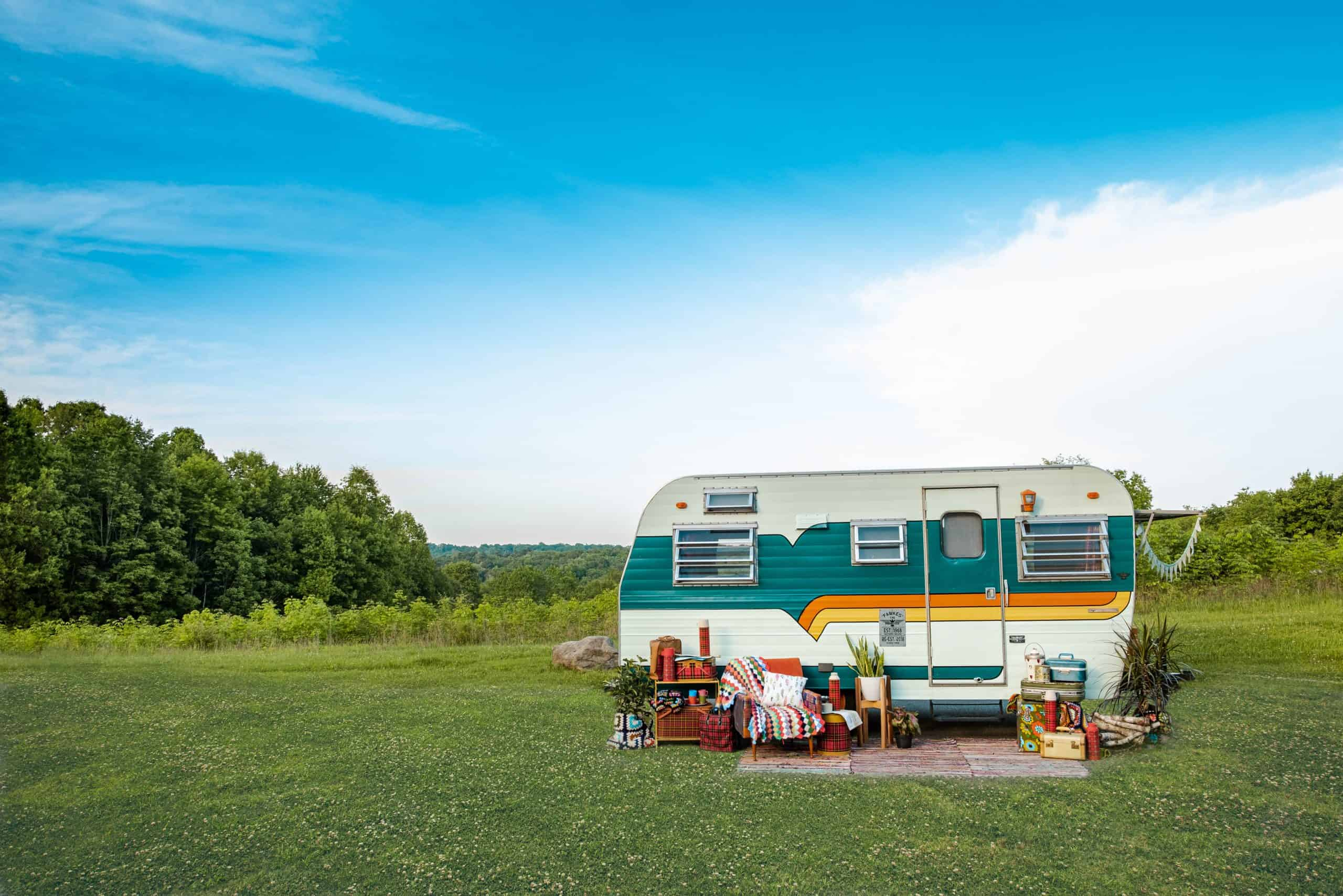travel trailer with outdoor patio set up