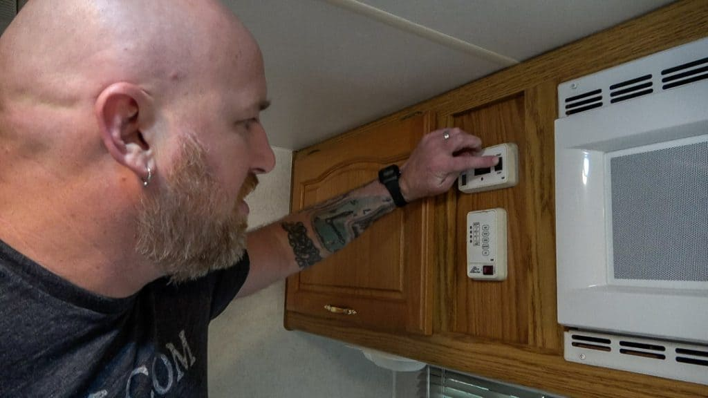 Turning the generator on during an RV inspection